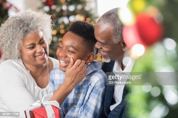 Grandma pinches grandson's cheek on Christmas morning
