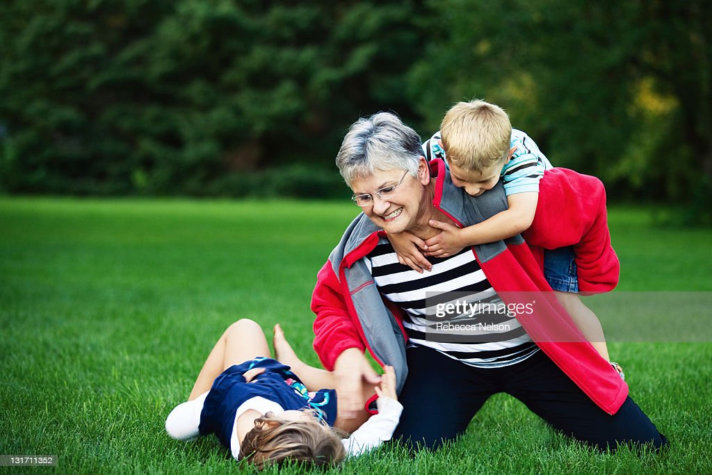 Grandma playing outside with her grandkids : Stock Photo
