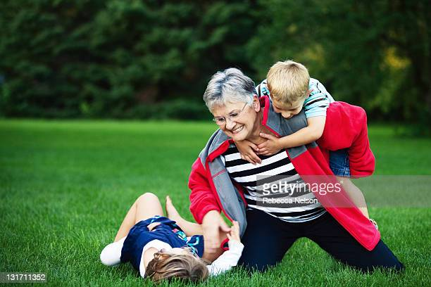 Grandma playing outside with her grandkids