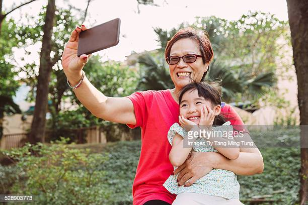 Grandma taking selfies with toddler joyfully