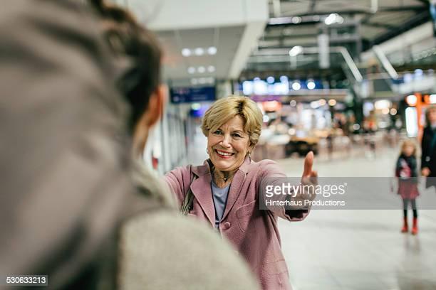 Grandma Welcoming Young Traveller