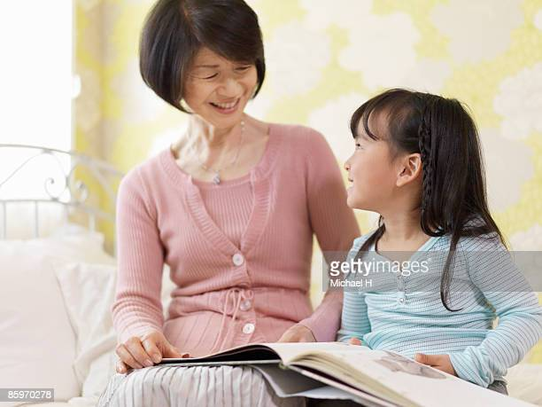 Grandma who reads picture book for girls