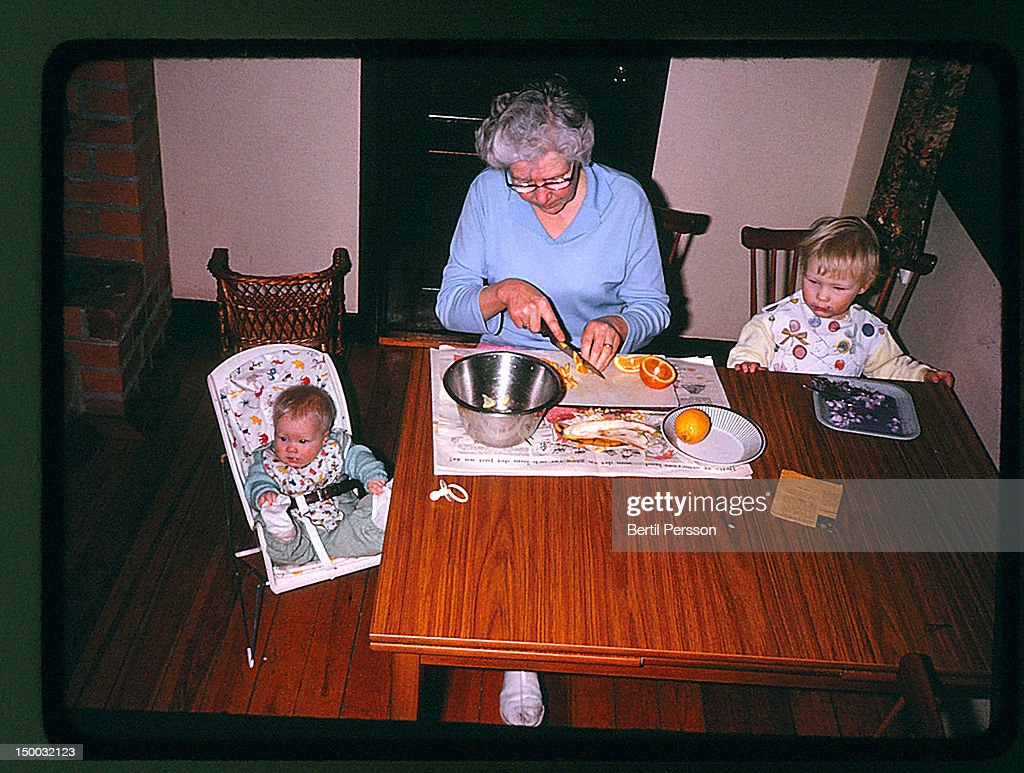Grandma with grandchildren at table : Stock Photo