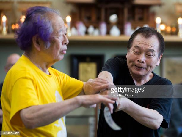 Grandmaster Masaaki Hatsumi demonstrates a martial arts technique during a lesson to his highlanked disciples at the Bujinkan dojo on May 21 2017 in...