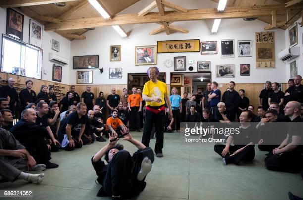 Grandmaster Masaaki Hatsumi demonstrates a martial arts technique during a lesson at the Bujinkan dojo on May 21 2017 in Noda Japan The Bujinkan is a...