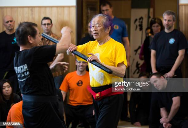 Grandmaster Masaaki Hatsumi uses a rod as he demonstrates a martial arts technique during a lesson at the Bujinkan dojo on May 21 2017 in Noda Japan...
