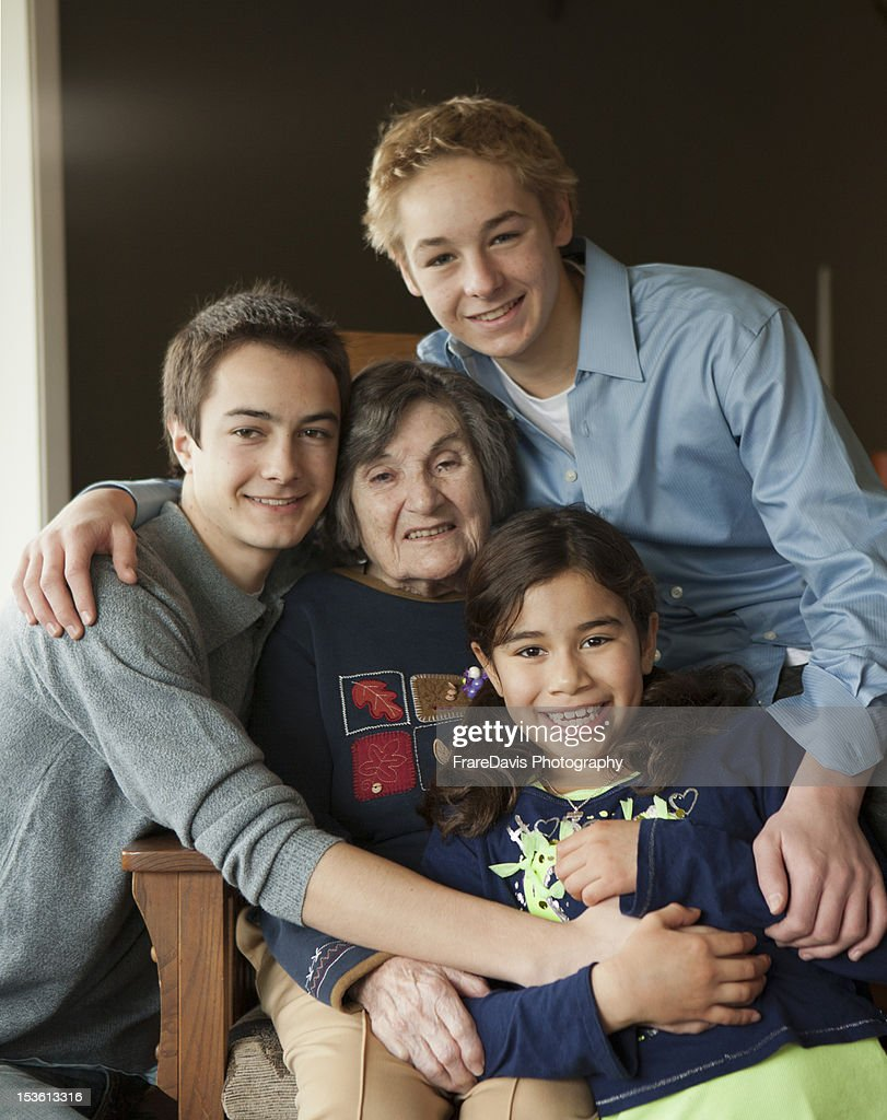 Grandmother and 3 grandchildren : Stock Photo