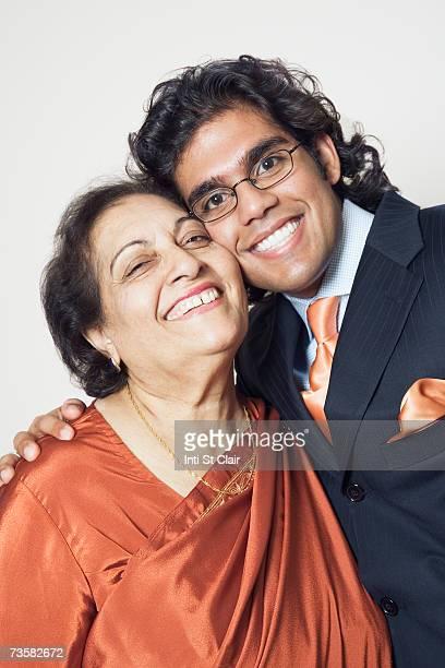 Grandmother and adult grandson, smiling, portrait
