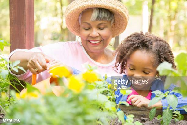 Grandmother and child gardening outdoors in spring.