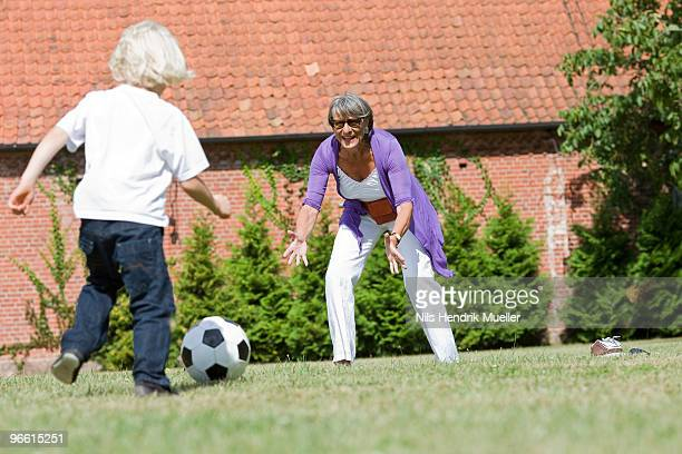 grandmother and child playing football