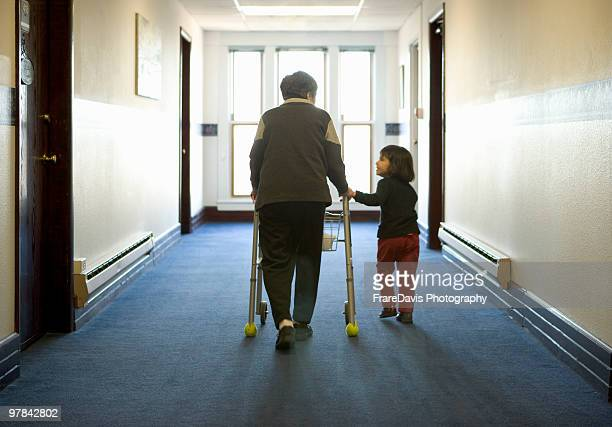 grandmother and child walking down hall