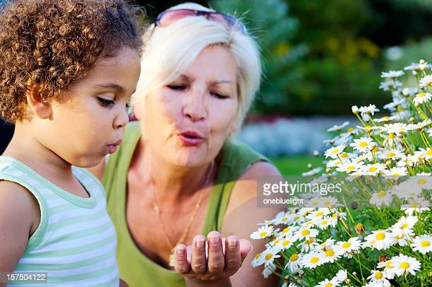 Grandmother and Dranddaughter Blowing a Flower Away ( serie)