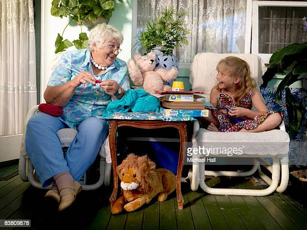 Grandmother and Grand Daughter at home knitting