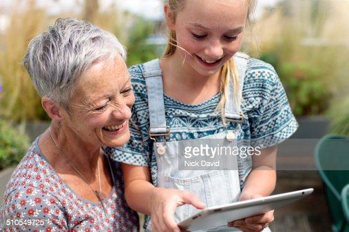 Grandmother and Grandaughter looking at tablet