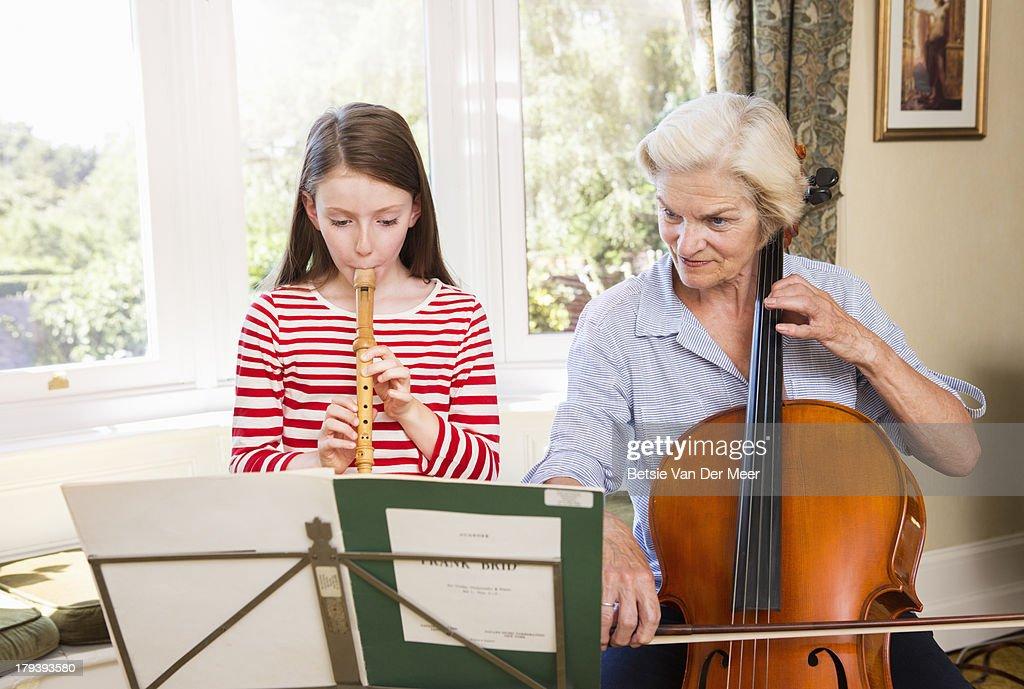 Grandmother and grandchild playing music. : Stock Photo
