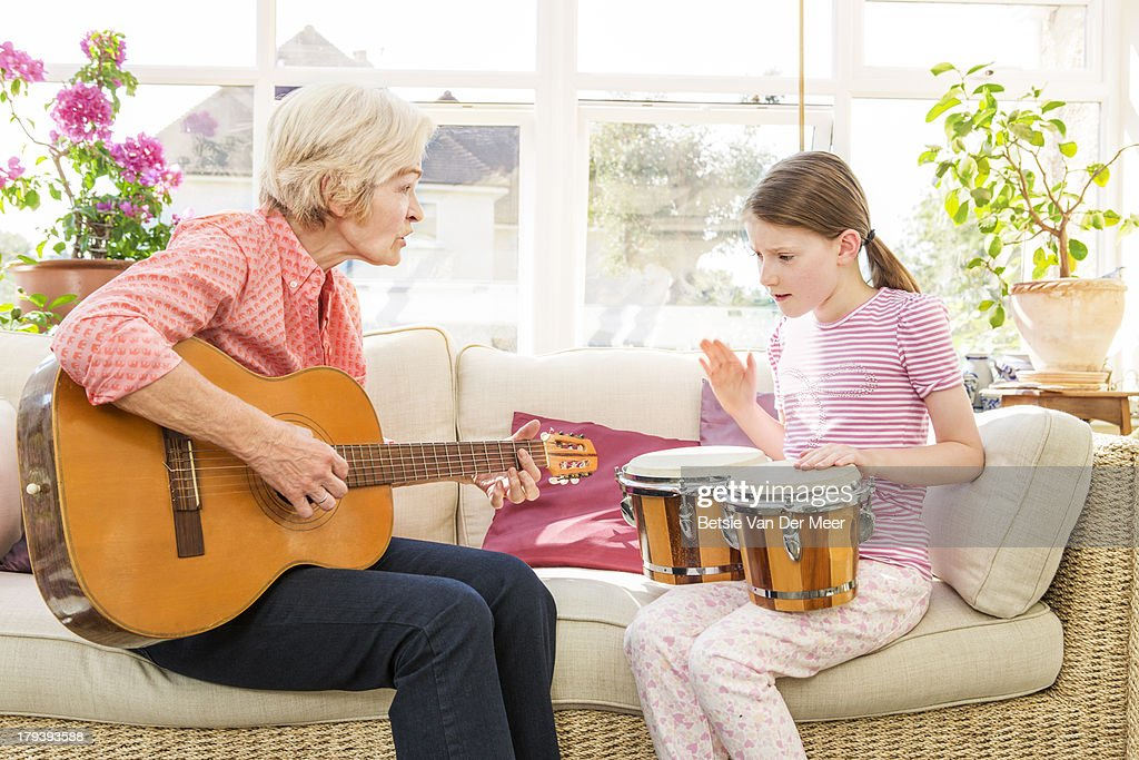 Grandmother and grandchild playing music. : Stock Photo