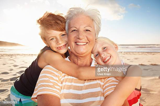 Grandmother and grandchildren on beach