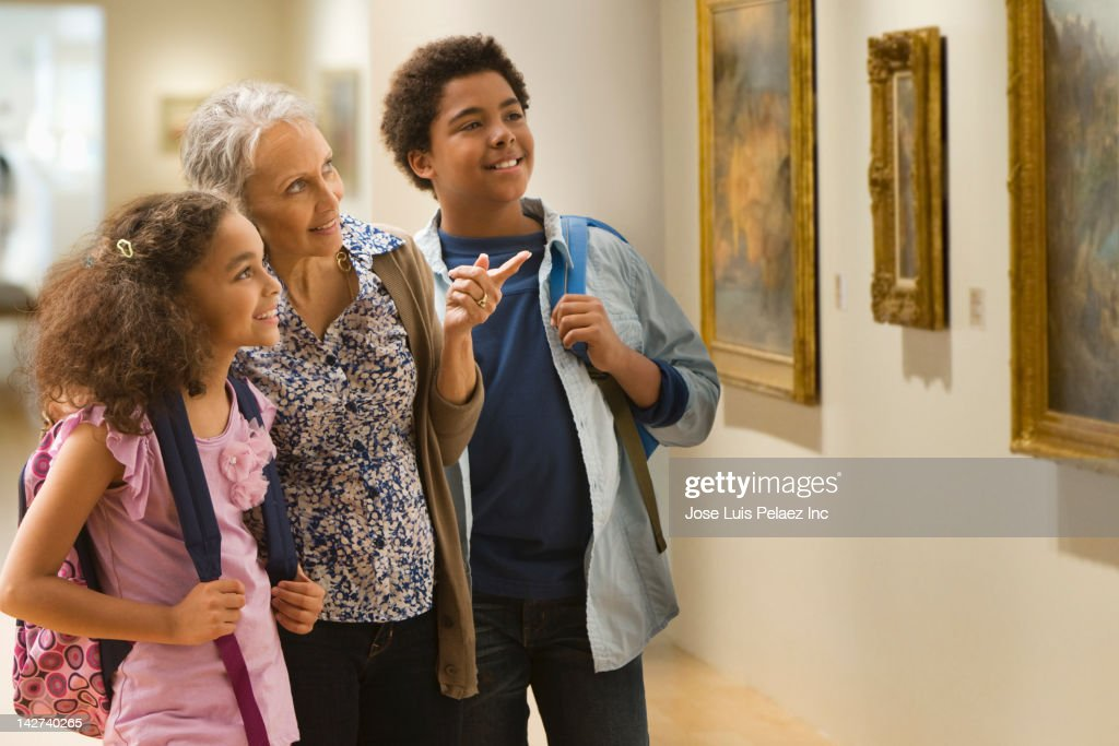 Grandmother and grandchildren visiting a museum : Stock Photo