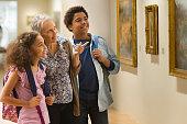 Grandmother and grandchildren visiting a museum