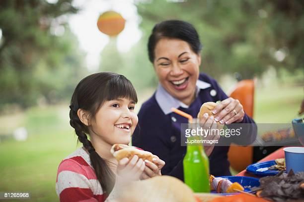 Grandmother and granddaughter at picnic