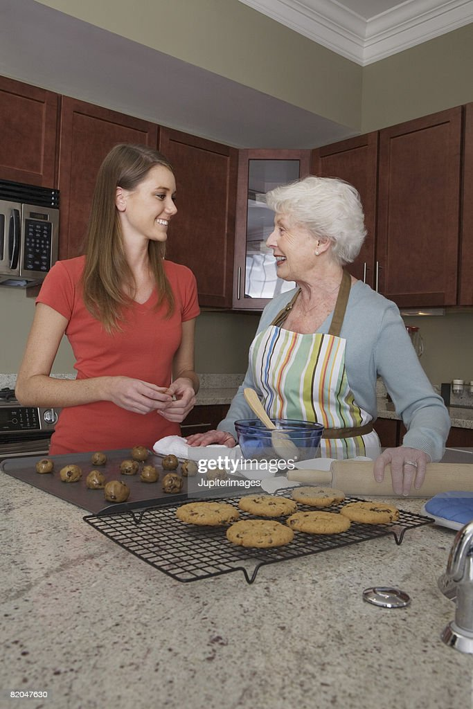 Grandmother and granddaughter baking cookies : Stock Photo