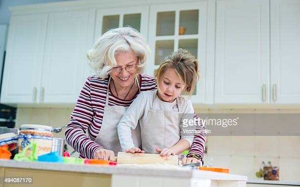 Grandmother and granddaughter baking together