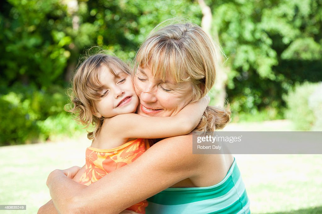 A grandmother and granddaughter being affectionate