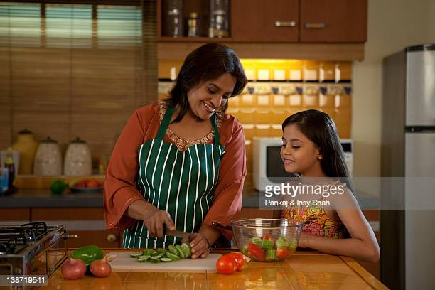 Grandmother and granddaughter cooking in the kitchen