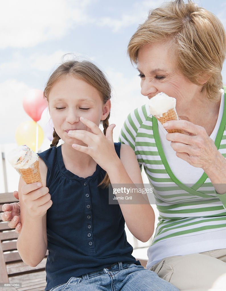 Grandmother and granddaughter eating ice cream : Stock Photo