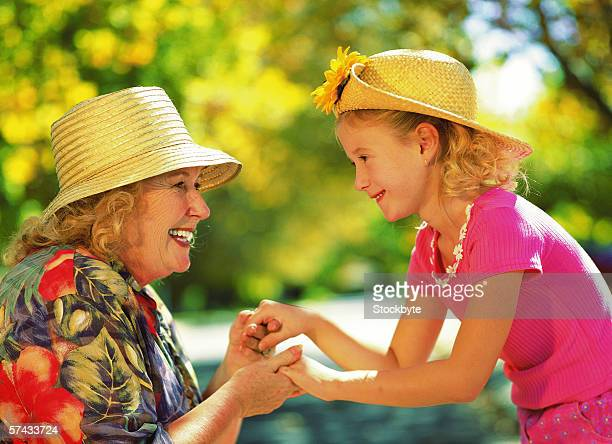 grandmother and granddaughter holding hands