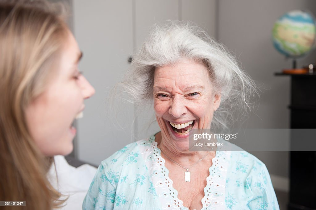 Grandmother and granddaughter laughing out loud