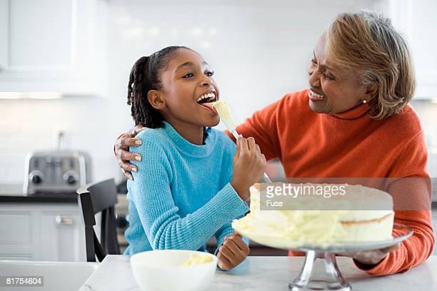 Grandmother and Granddaughter Making Cake