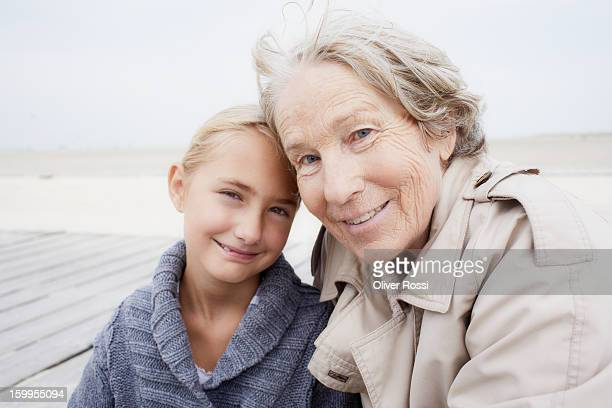 Grandmother and granddaughter on the beach