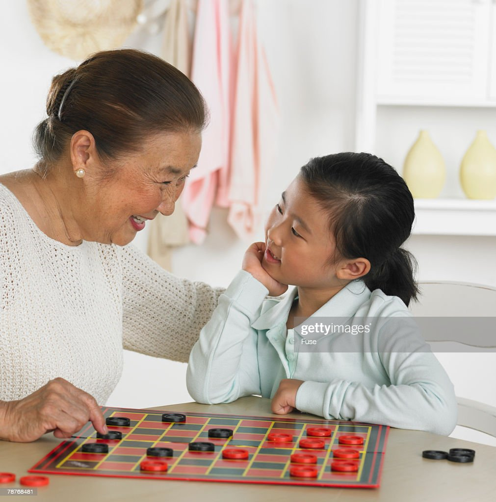 Grandmother and Granddaughter Playing Checkers