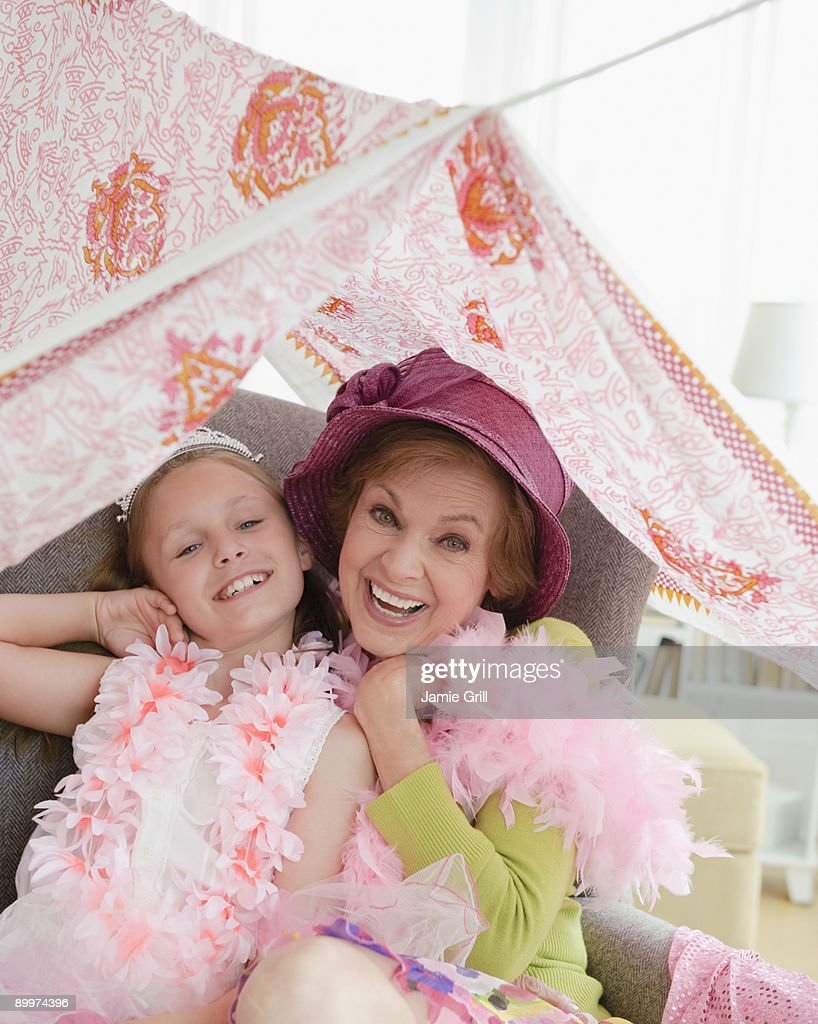 Grandmother and granddaughter playing dress up : Stock Photo