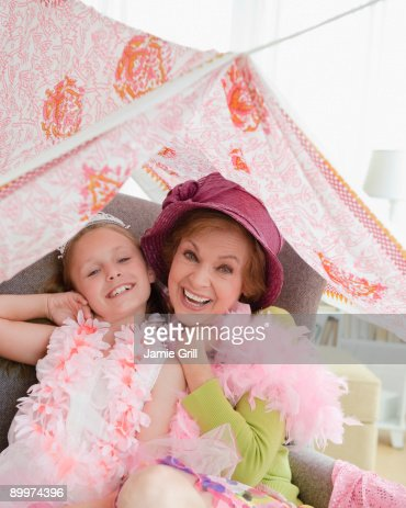Grandmother and granddaughter playing dress up