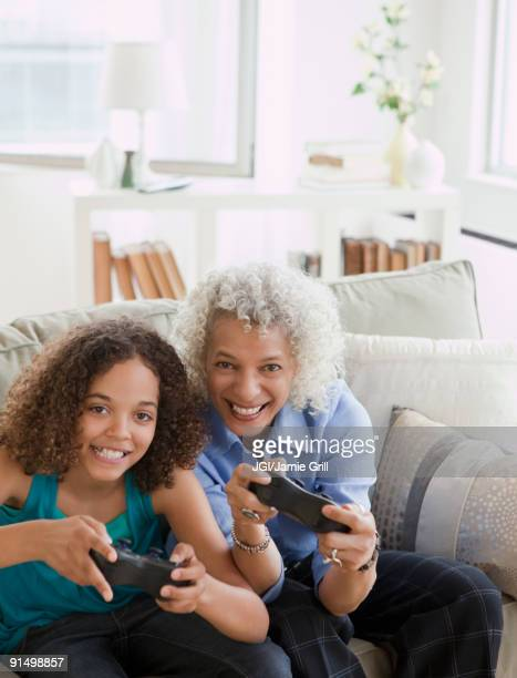 Grandmother and granddaughter playing video game