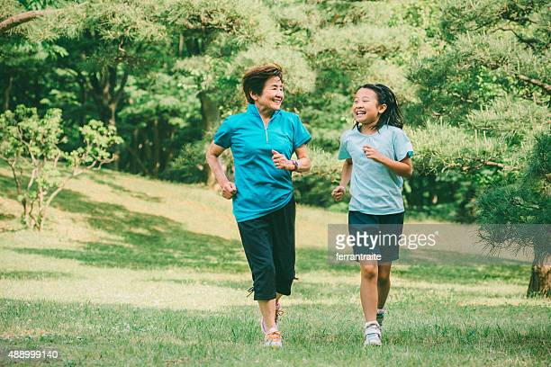Grandmother and granddaughter running together