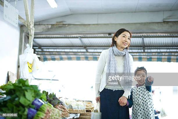 Grandmother and granddaughter shopping at store