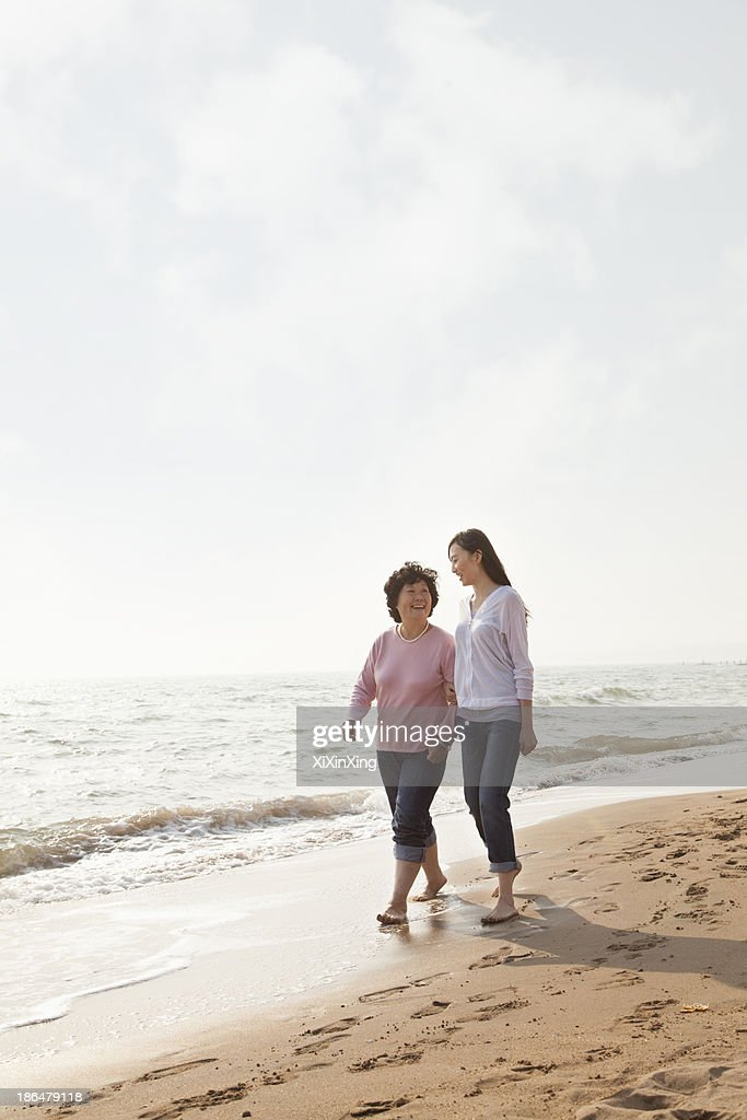 Grandmother and Granddaughter Taking a Walk by the Beach : Stock Photo
