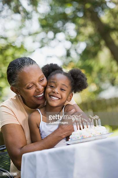 Grandmother and granddaughter with birthday cake
