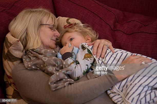 Grandmother and grandson asleep on sofa