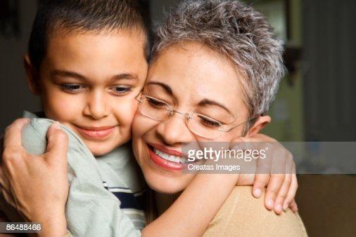 Grandmother and grandson embracing : Foto de stock