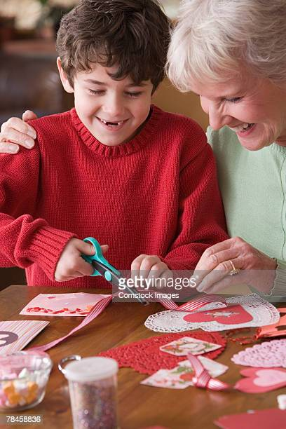 Grandmother and grandson making valentines