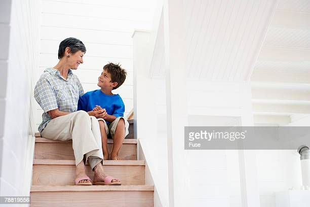 Grandmother and Grandson on Stairs