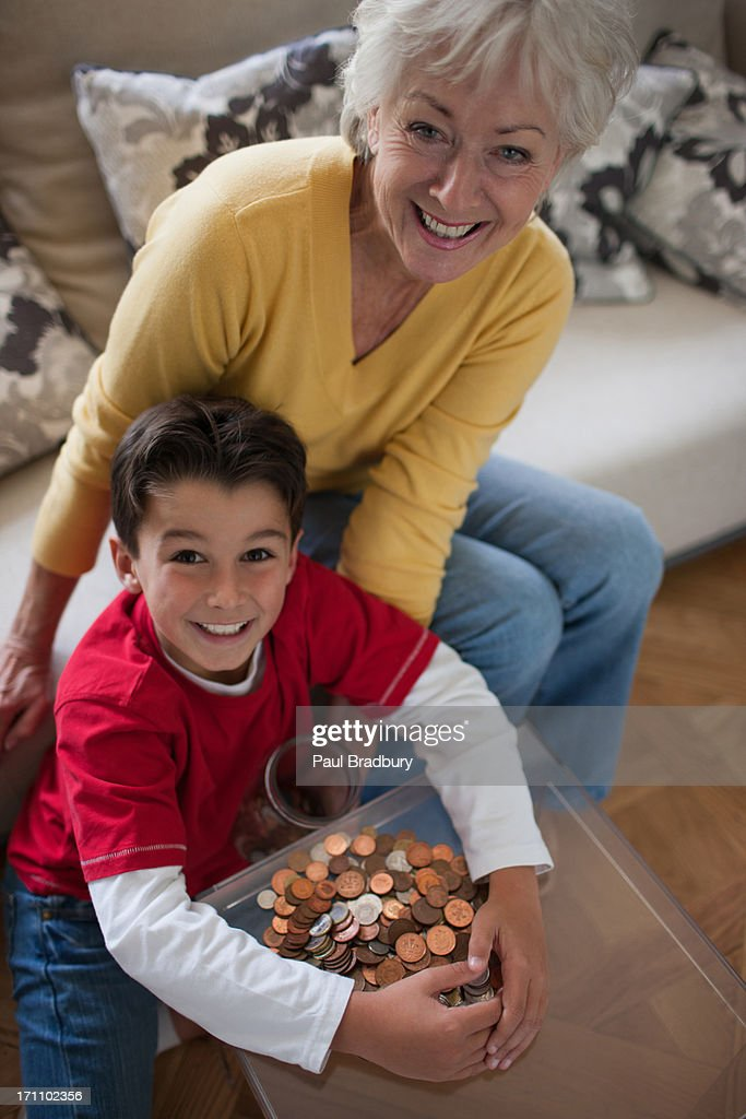 Grandmother and grandson protecting stacks : Stock Photo