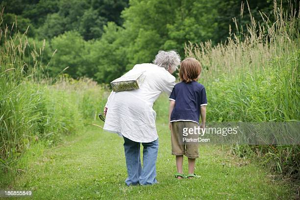 Grandmother and Grandson Taking a Walk on Beautiful Trail