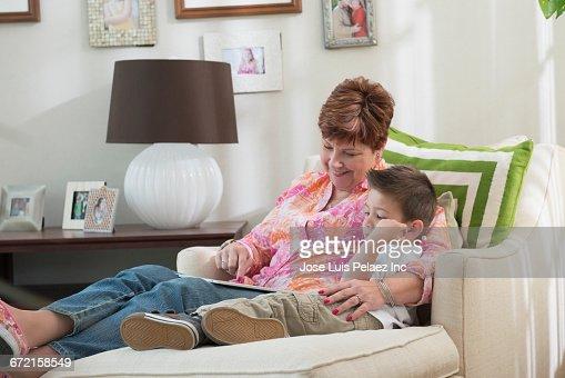 Grandmother and grandson using digital tablet
