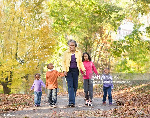 Grandmother and grandsons walking in park