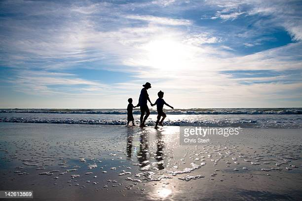 Grandmother and Grandsons walkng on the beach